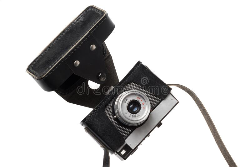 Old retro film camera in a black leather case, isolated on white background.  royalty free stock photography