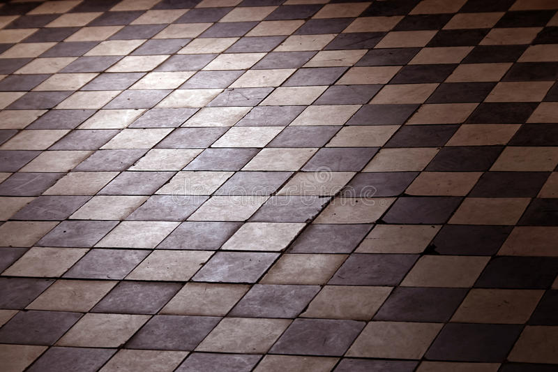 Old retro floor made of dark and bright squares stock photo