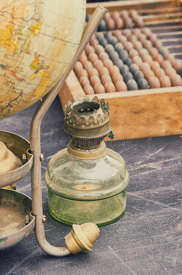 Old retro objects antique globe, gas lamps and accounting abacus stock photos