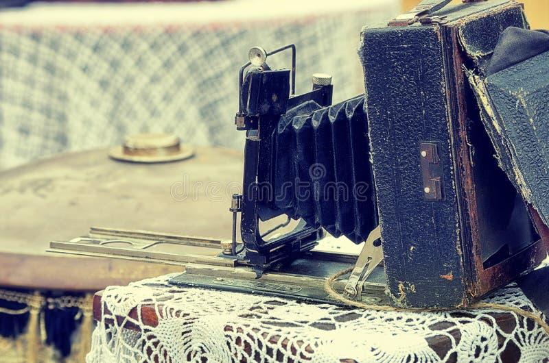 Old retro objects antique photo camera, vintage image retro style effect. stock photo