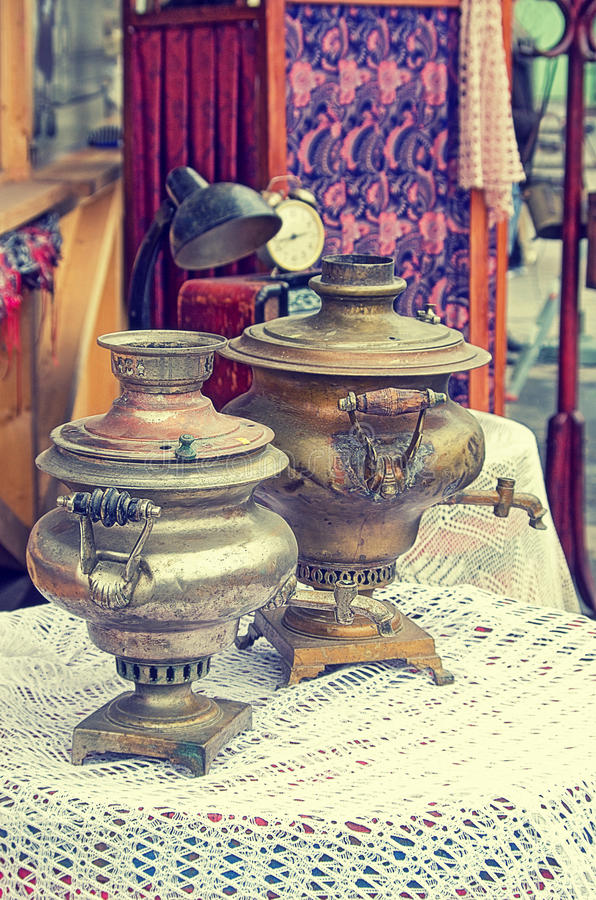 Old retro objects antique samovar for hot tea on the table, vintage image retro style effect. stock image