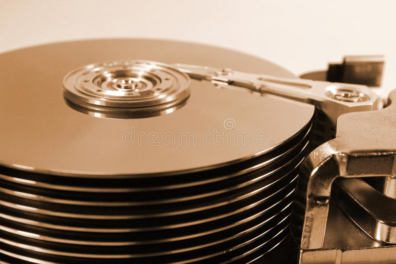 Old retro open hard disk drive. Thick stack of ten platters and. Magnetic heads royalty free stock photography