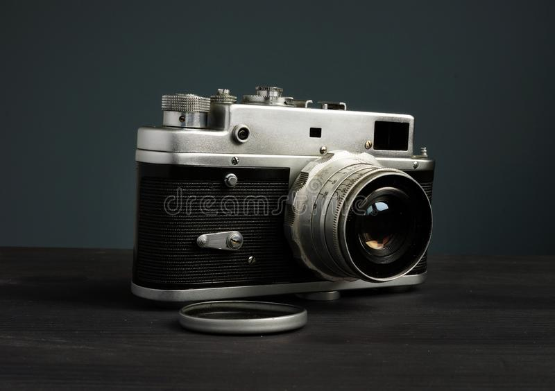 Old retro photo camera in the dark. Vintage devices royalty free stock image