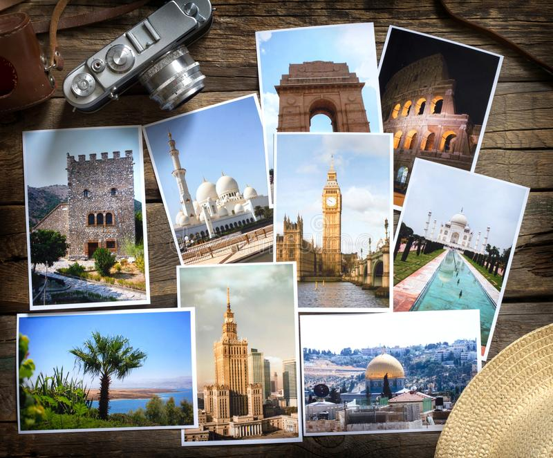 Old retro pictures and camera on wooden table globetrotter photography travel collage concept royalty free stock photo