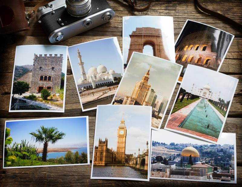 Old retro pictures and camera on wooden table globetrotter photography travel collage concept. Still life stock photos