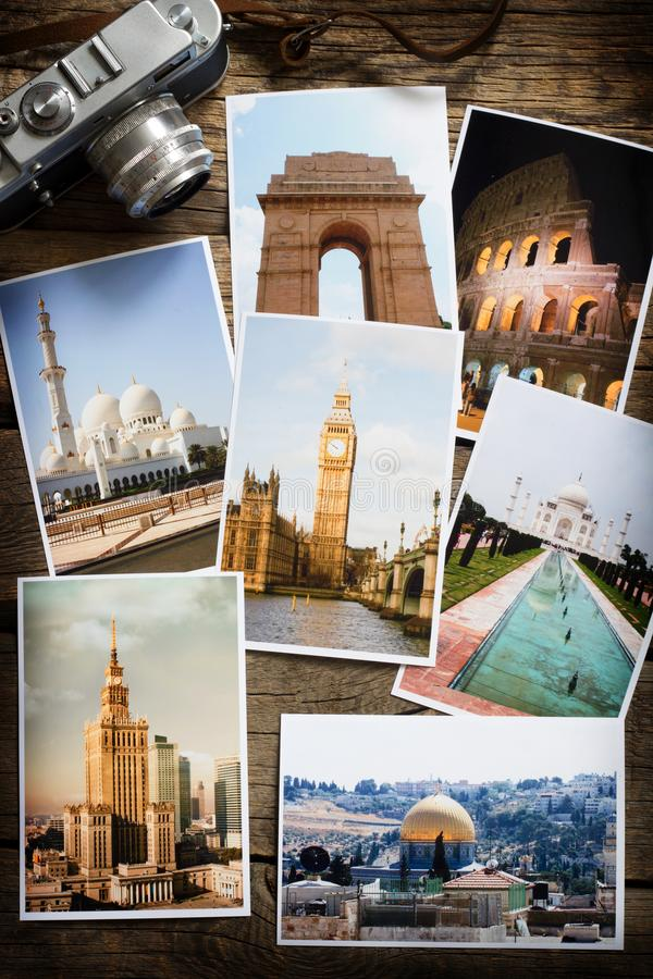 Old retro pictures and camera on wooden table globetrotter photography travel collage concept. Still life royalty free stock photos