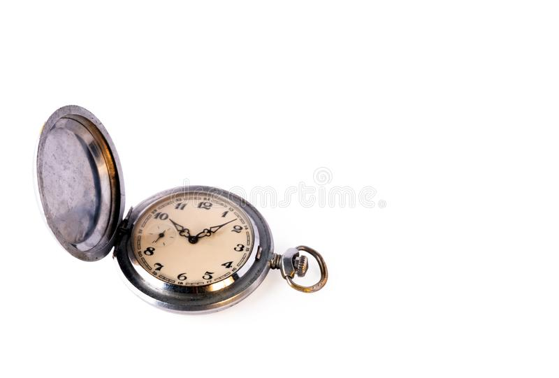 Old retro pocket watch with scratches isolated on a white background. Copy space. Object for design on the theme of time royalty free stock photography