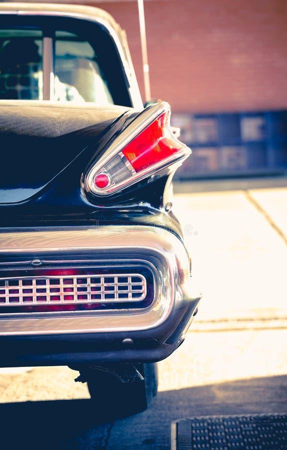 Free Old Retro Vintage Classic Black Chromed Car Park At Petrol Station In Woking UK. Stock Images - 84643074