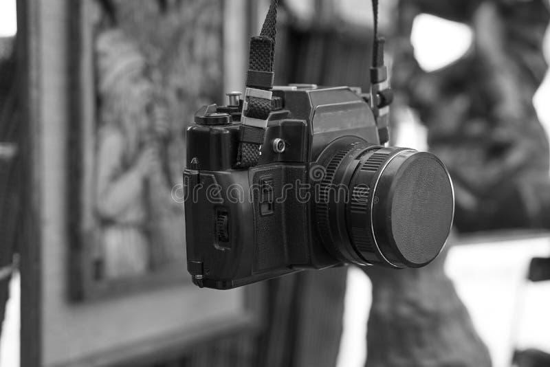 Old retro vintage film camera on a neck strap stock photo