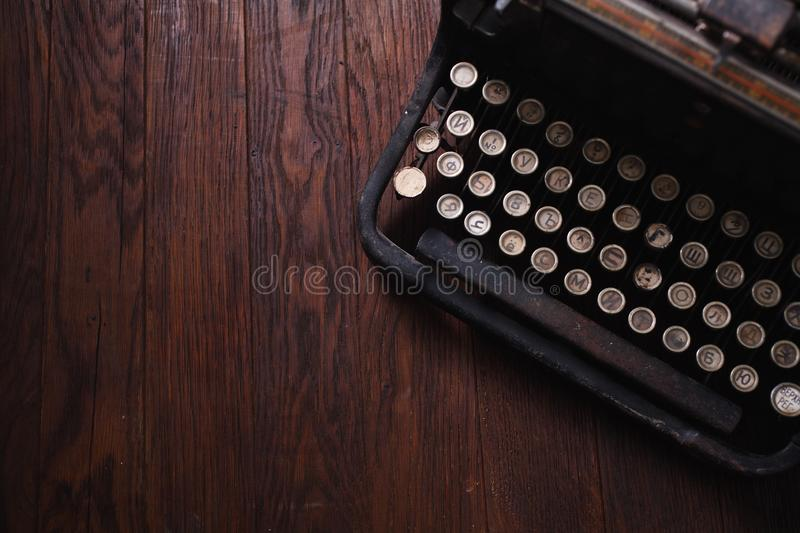 Old retro vintage typewriter on wooden board. Old retro vintage typewriter on wooden table stock photos