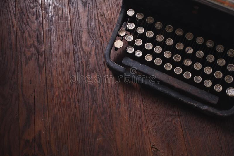 Old retro vintage typewriter on wooden board royalty free stock photos