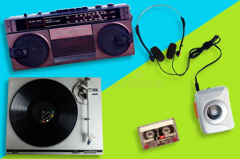 Old retro Vinyl record player or turntable, Portable tape player with radio and cassette tape and Headphone stock images