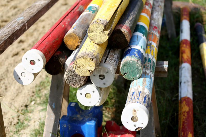 Multi colored image of show jumping poles stacked at the show jumping arena royalty free stock photo