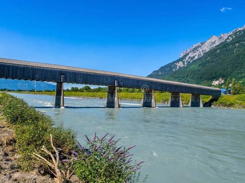 Old Rhine Bridge from Switzerland to Liechtenstein, Vaduz, Liechtenstein. Old wooden Rhine Bridge from Switzerland to Liechtenstein, Vaduz, Liechtenstein, Europe stock photography