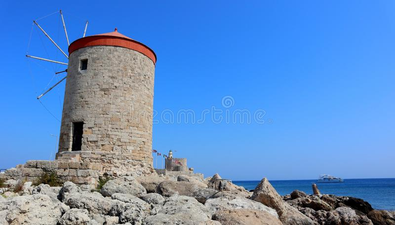 Old Rhodes windmills at the harbour royalty free stock image