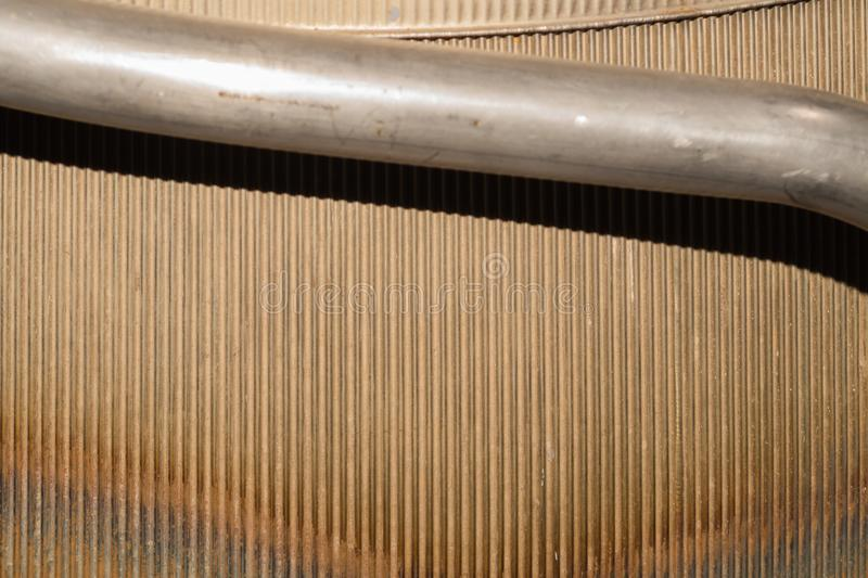 Old ribbed metal texture. corrugated steel backdrop. Old ribbed metal texture. corrugated steel background. metal pipe, industrial, lines, material, pattern royalty free stock images