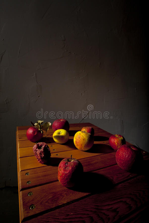 Old ripe apples on table royalty free stock photography