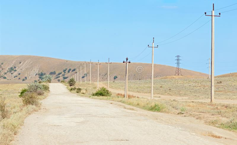 The old road in the arid region with concrete poles for electricity stock images