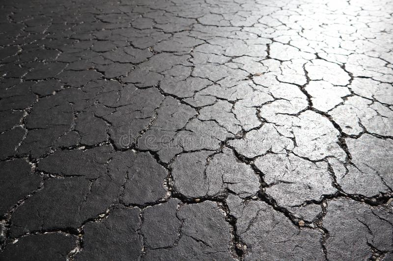 Old road background - surface of grey cracked asphalt texture close up, city street of Miami. black cracked asphalt. abstract ston. E background stock photo
