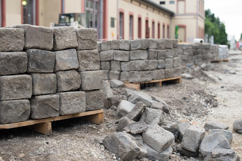 Old road granite blocks, cubes stacked together. Old stone cobbles. Old road material stock photo