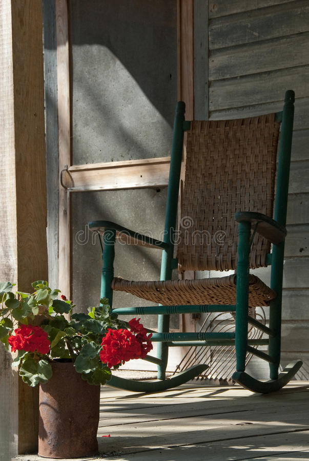 Download Old Rocking Chair On Cracker House Porch Stock Photo