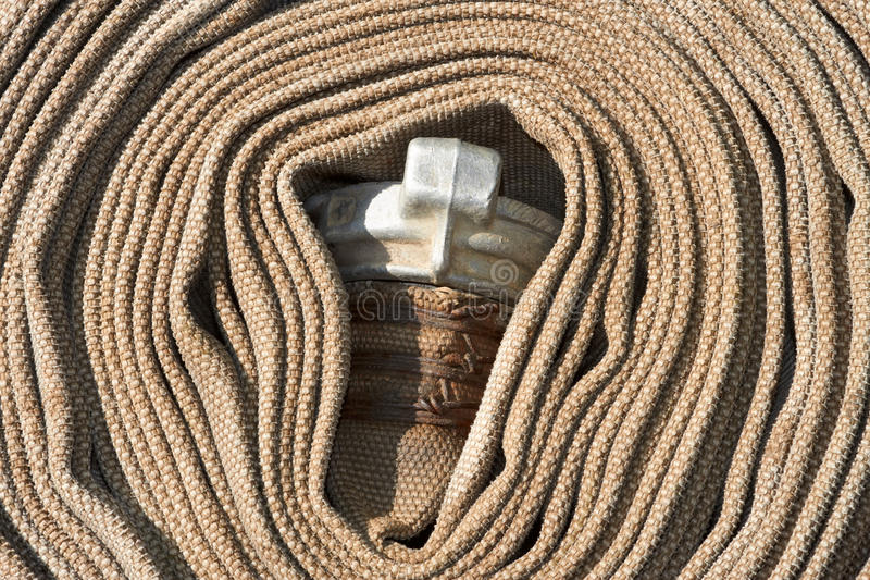 Download Old Rolled Fire Hose With Nozzle Stock Image - Image: 25639001