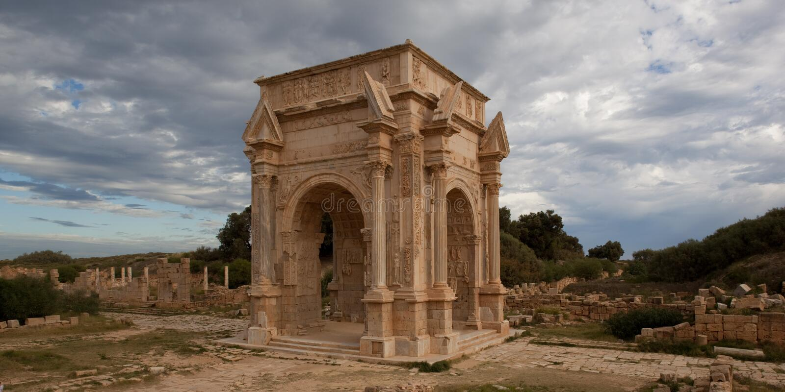 Old Roman arch in Leptis Magna Libya royalty free stock image