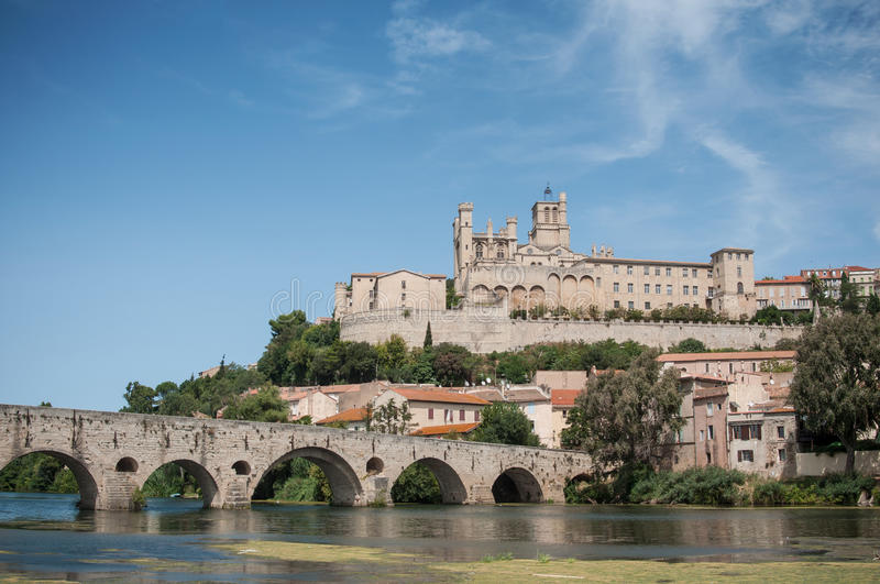 Old roman bridge and cathedral St Nazaire in Beziers. Panorama of old roman bridge and cathedral St Nazaire in Beziers the city in south France stock image