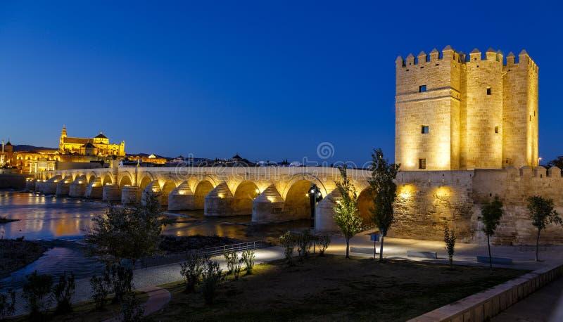 Old roman bridge and tower Calahora at night, Cordoba. Andalusia, Spain royalty free stock image
