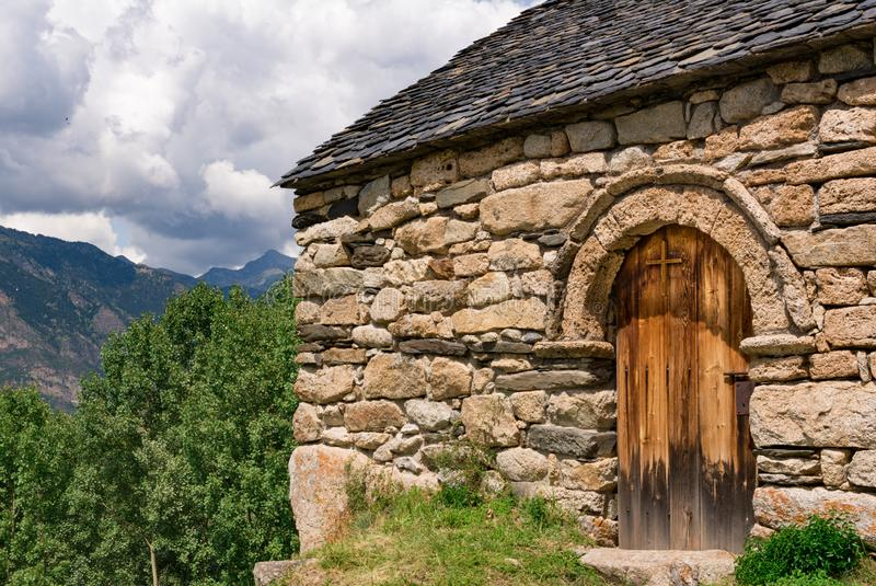 Old Romanesque wooden cross and door of the Sant Quirc de Taull hermitage, Catalonia, Spain. Old Romanesque wooden cross and door of the Sant Quirc de Taull royalty free stock image