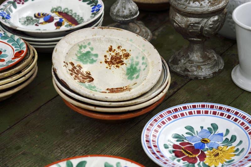Old romanian ceramic plates on flea market. Old romanian ceramic plates display for sale at the flea market in Romania stock images