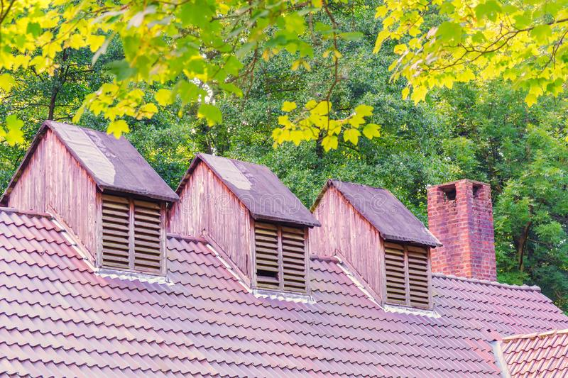 Old roof construction with roof skylights stock photography