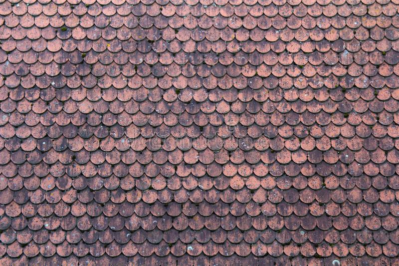 Old roof covered with red tiles for usage as background royalty free stock images
