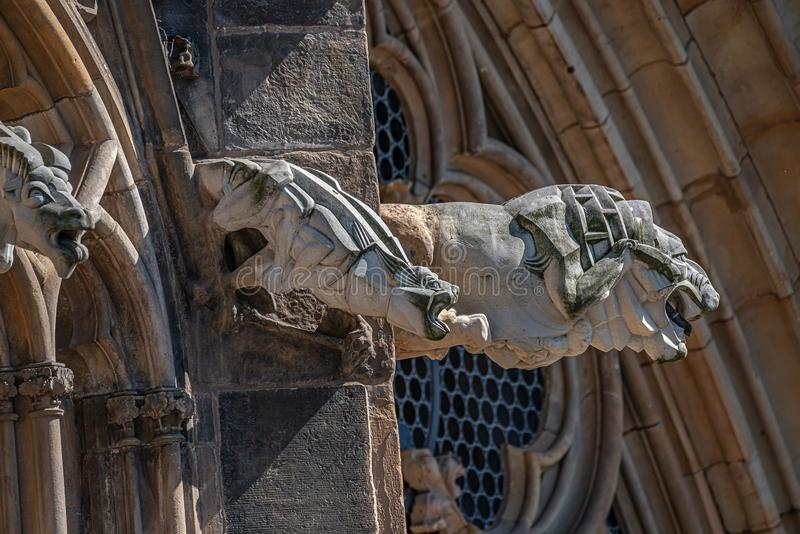 Old roof figures of scary gargoyles at main facade of cathedral in Magdeburg, Germany, closeup, details stock photo
