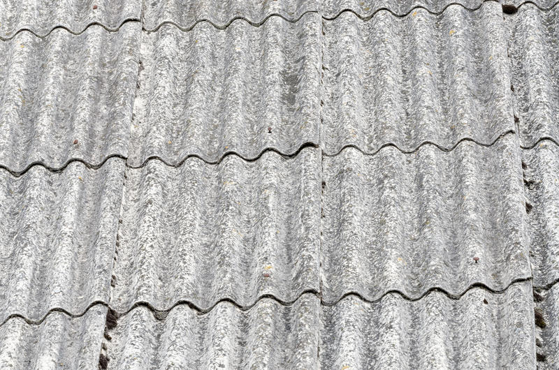Old roof. Old unhealthy fiber asbestos home roof stock photos