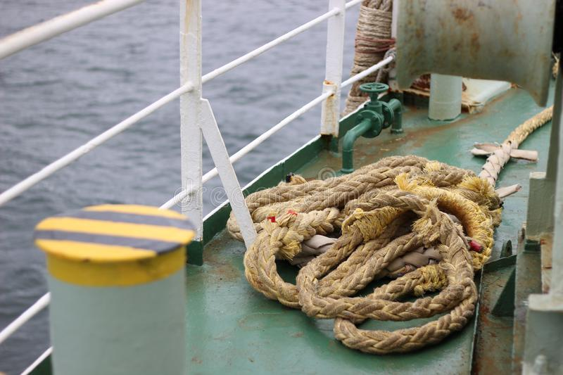 An old rope on the deck of a ship royalty free stock image