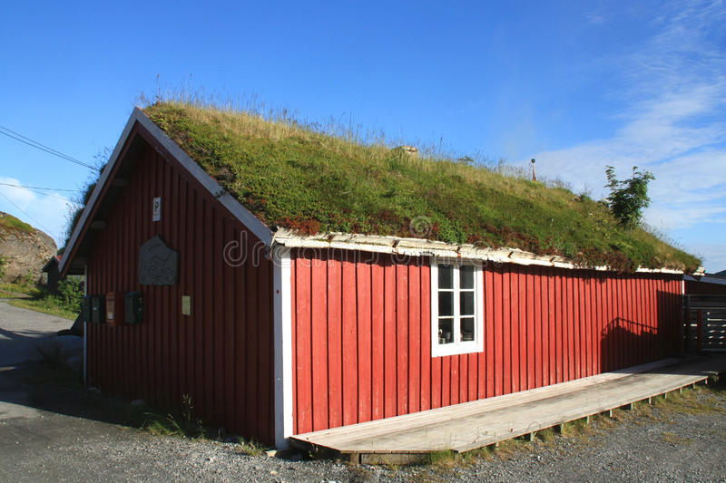 Old rorbu with grass on the roof in Sund stock photo