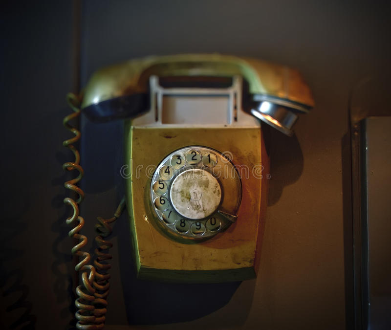 Old Rotary Dial Telephone. An old dirty rotary dial telephone stock photography