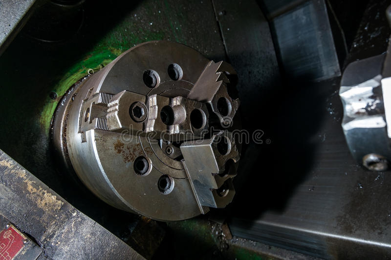 Old rotary lathe machine tool equipment in factory interior. Not in work stock photo