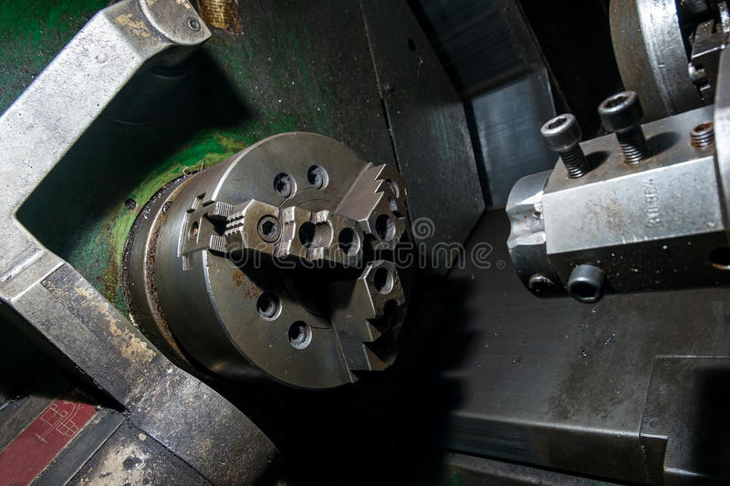 Old rotary lathe machine tool equipment in factory interior. Not in work stock photos