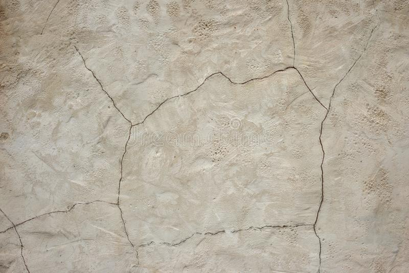 Old rough gray wall with a crack on plaster.  Structured Grunge Textured Background stock photo