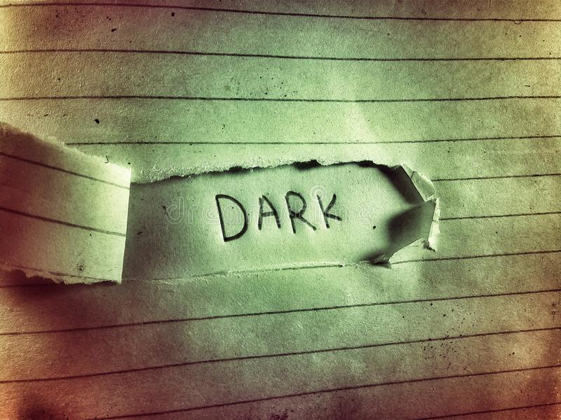 On the old and rough paper page word written dark by pencil stock images
