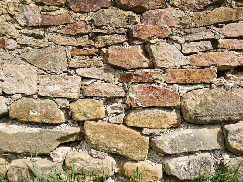 Old rough stone texture brick surface wall. L exterior light background royalty free stock photo