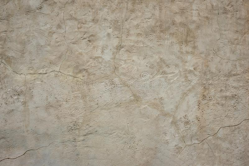 Old rough  wall with a crack on plaster.  Structured Grunge Textured Background. Old rough gray wall with a crack on plaster.  Structured Grunge Textured royalty free stock photo