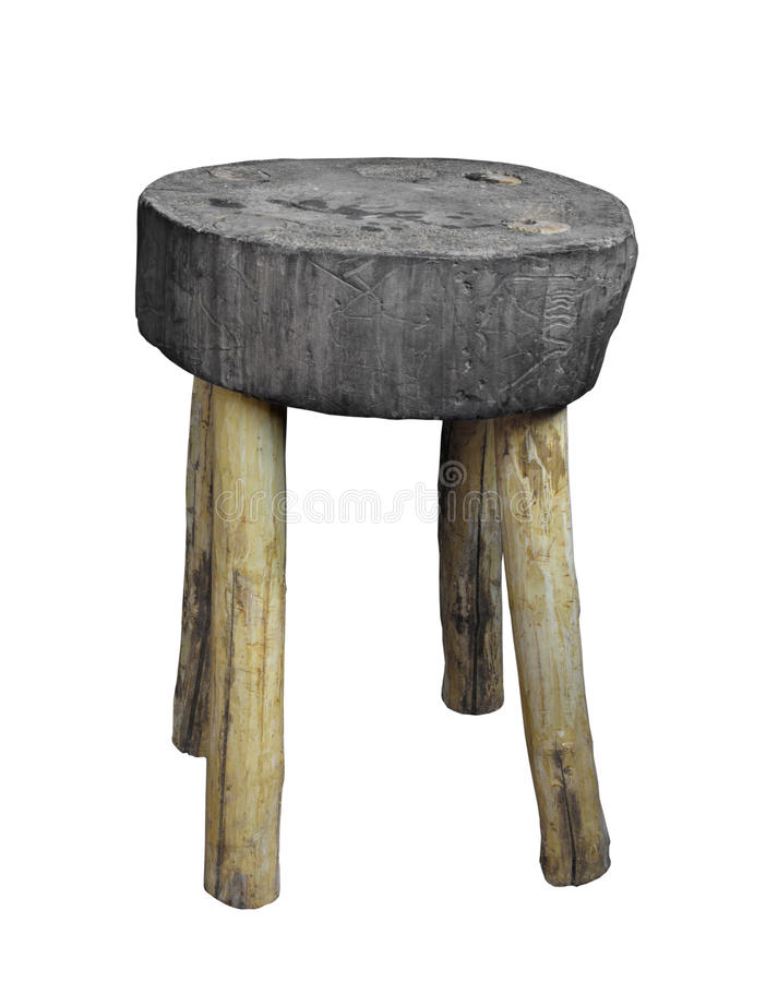 Old round wood stool isolated. Old short round four-legged stool, the seat made from a slice of a large log and the legs from small logs. Isolated on white stock images