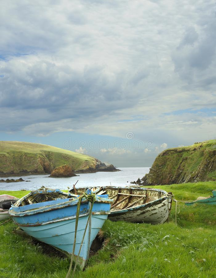 Old Row Boats on the Coastline of Shetland Islands, Scotland. Old Row Boats on the Rugged Coastline of the Shetland Islands, Scotland stock photo