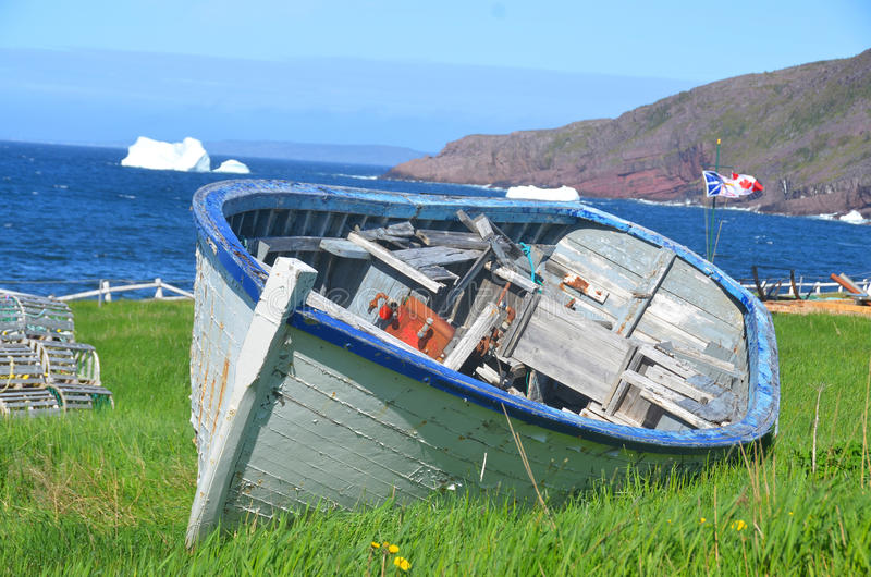 Old rowboat. TRINITY NEWFOUNDLAND JUNE 12 2014 Old rowboat in Trinity Newfoundland. The town contains a number of buildings recognized as Registered Heritage stock photos