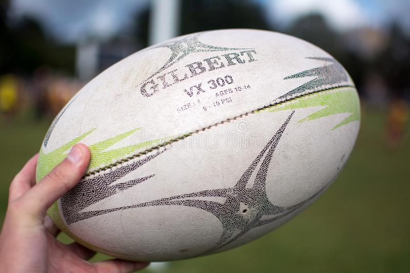 Old rugby ball Gilbert VX 300. Yoshkar-Ola, Russia - August 22, 2018 Old rugby ball Gilbert VX 300. Training rugby ball. Designed for games and training in all royalty free stock photos