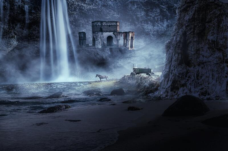 Old ruin with waterfall in fantasy scene stock photo