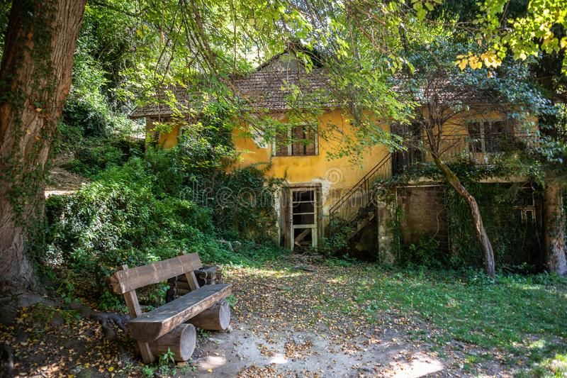 Old ruined and abandoned house next to the waterfall in Martin Brod. Bosnia and Herzegovina royalty free stock photos